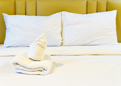 white sheets and linen on bed